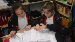 Alicia and Dora teaching each other some maths tricks