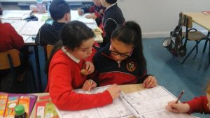 Teacher Abbie and Sabrina working together