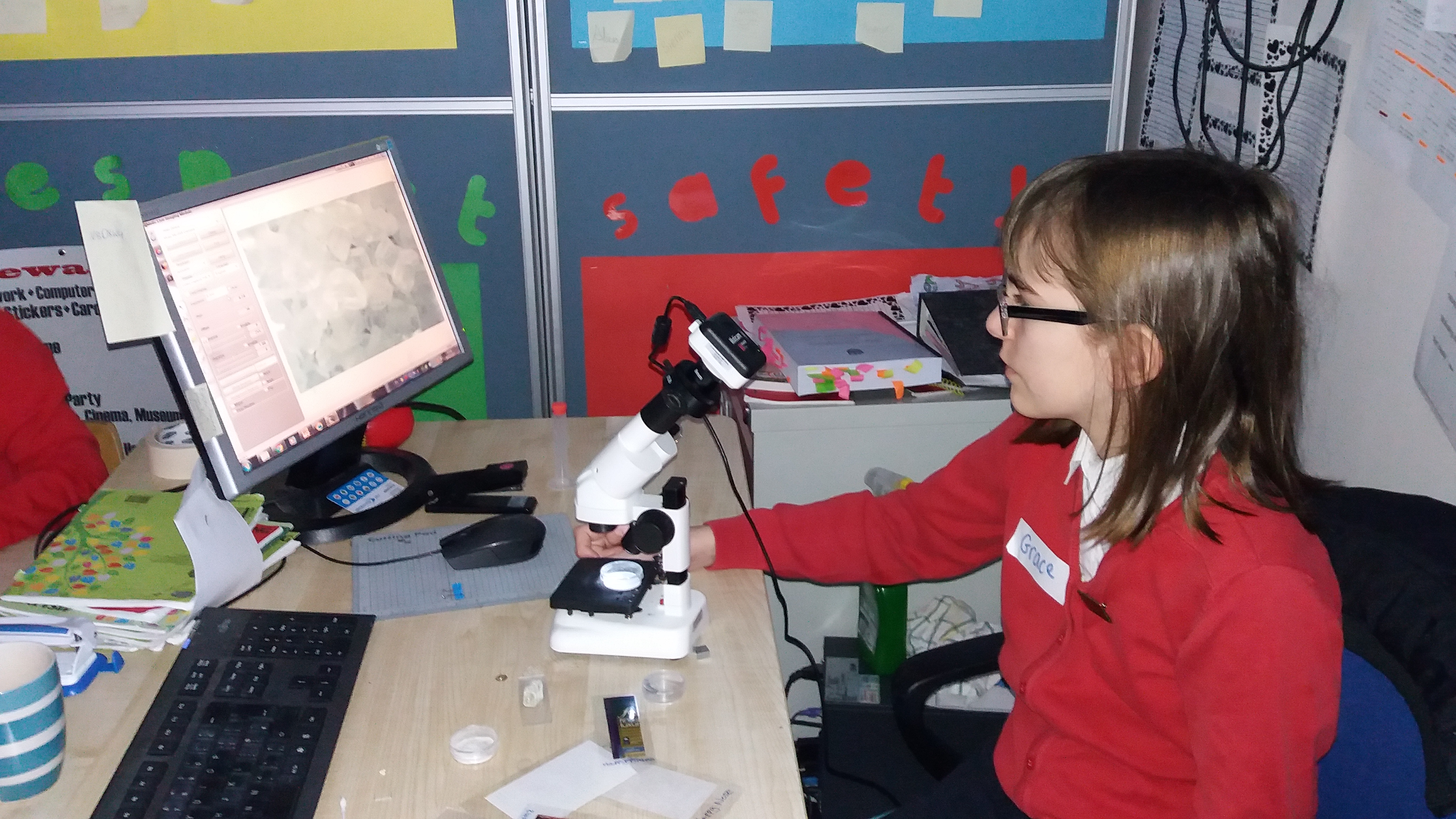 Grace from 6th attached her microscope to the computer to share her findings with the class